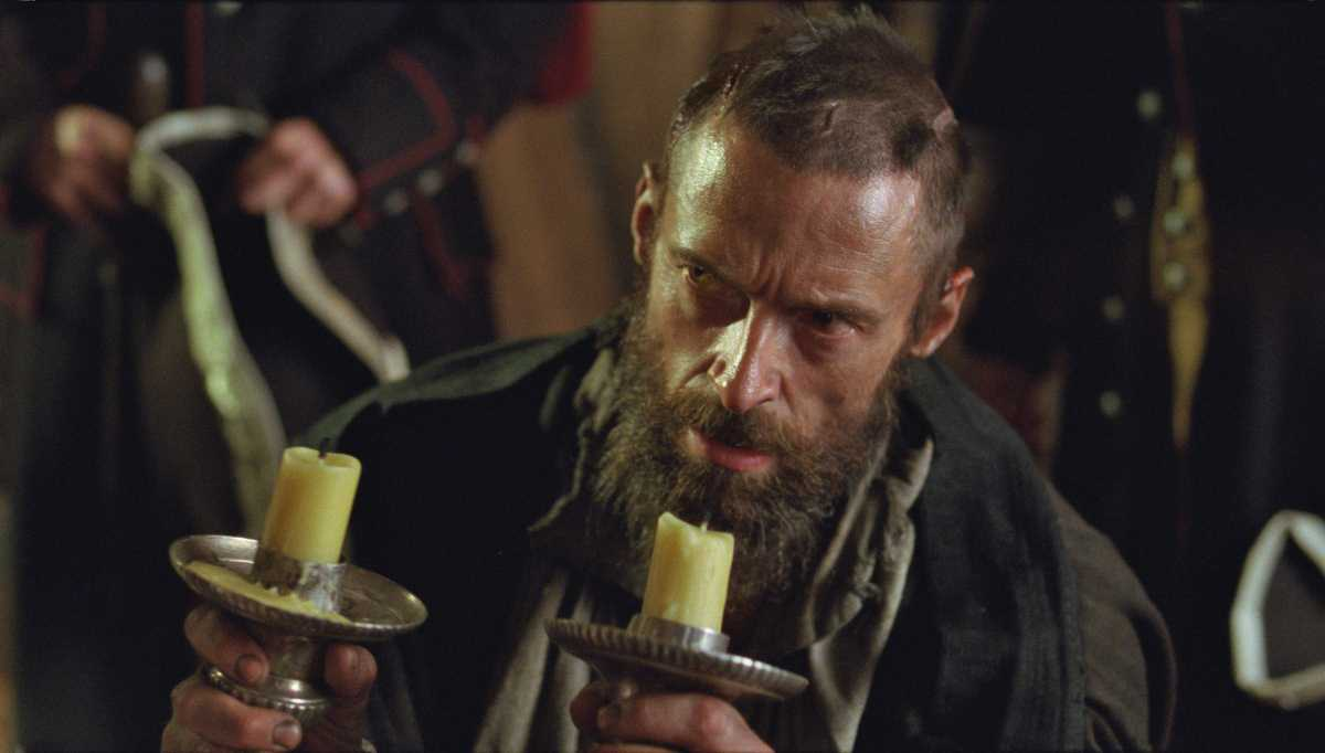 From the movie: Valjean accepts as a free gift the silver he stole from the Bishop