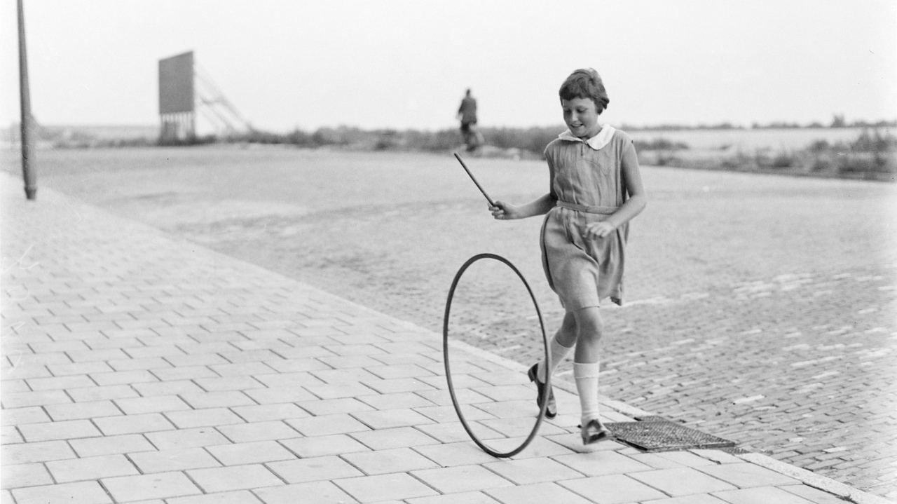 Photo: Girl rolling a hoop